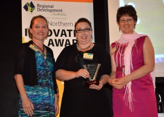 "Kate James from New England Mutual presented the 'Professional and Retail Services Category' award to Kelly Foran and Bronwyn Clarke of the ""Friendly Faces Helping Hands"" information service operated from a farm 60km east of Boggabri."