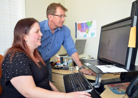 Regional Development Australia Northern Inland Finance and Project Officer Rebecca Wright and Senior Research Economist David Thompson monitor the non-farm business drought survey results.