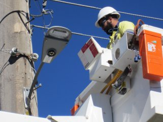 Essential Energy contractors installing the new LED street lights