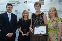 Technical Services Manager for Goldwind Australia, Steven Nethery presented a White Rock Wind Farm 'Research and Education' finalist trophy to HealthWise New England North West's Fiona Strang, Anne Williams and Linda Foskey.