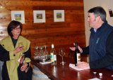 At Mihi Creek cellar door, Andrew Close talks about his wine with Julie Keene from Armidale's Cedar Lodge Motel.