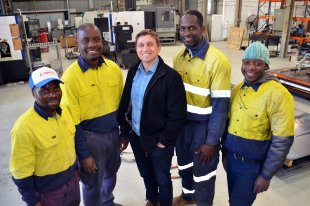 Fitter/machinists Maxwell Matandaudyi and Courage Munyakari, Tamworth's Apollo Engineering Managing Director Dave Errington, and first-class welders, Wellington Bigone and Komborero Anthony Chikonyera